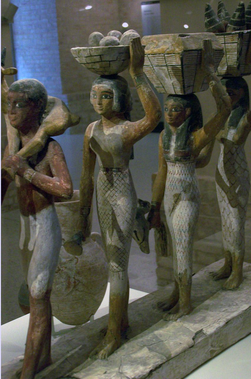 Porteurs d'offrandes en bois peint