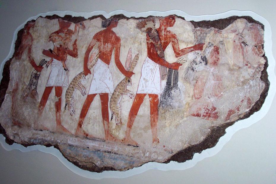 Les serviteurs portent des lièvres comme offrandes à Nebamon
