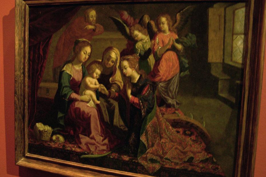 Peinture représentant un enfant entouré de femmes