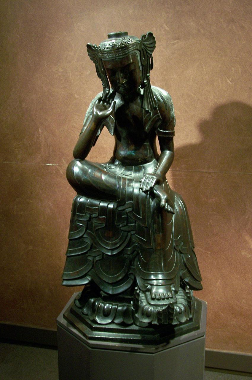 Statue en bronze d'une femme - origine Asie