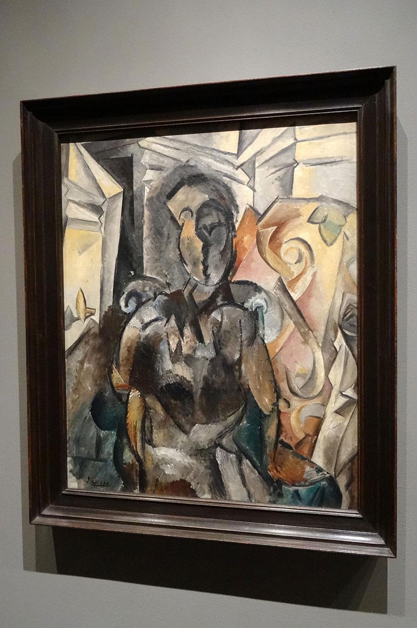 Femme assise dans un fauteuil de Pablo Picasso