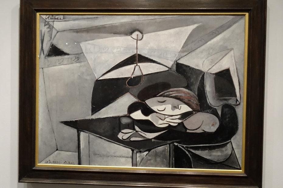 Femme endormie à une table de Pablo Picasso