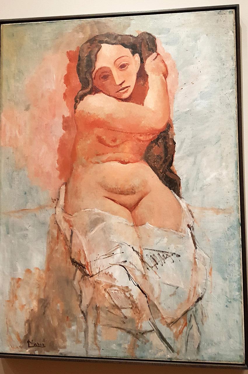 Femme se tressant les cheveux de Pablo Picasso