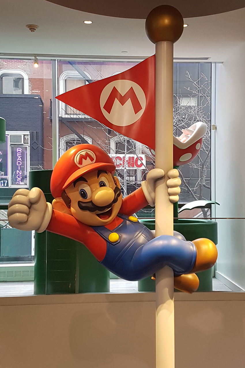 Super Mario accroché à son drapeau